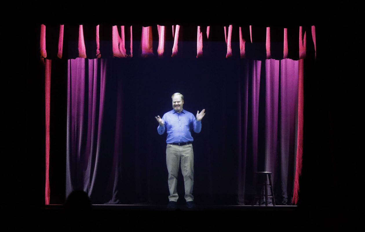 A hologram of comedian Jim Gaffigan plays in the Hologram Theater at the National Comedy Center in Jamestown. (Mark Mulville/Buffalo News)