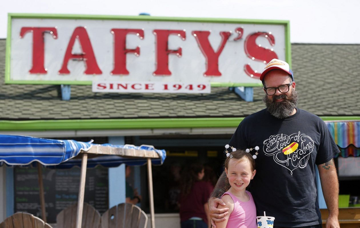 Hot dog aficionado Jim Gang with his daughter Elenor Russo at Taffy's during the quest to track down the best hot dogs in the area. (Mark Mulville/Buffalo News)