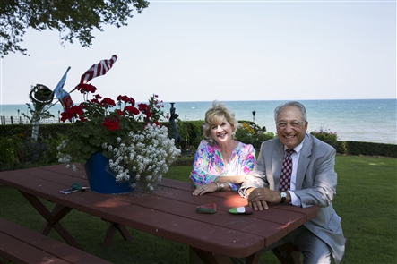 Nick and Beth Buscaglia live in a lakeside house with beautiful landscaping, including a 300-foot English-style garden that leads from the street to the shore of Lake Erie.