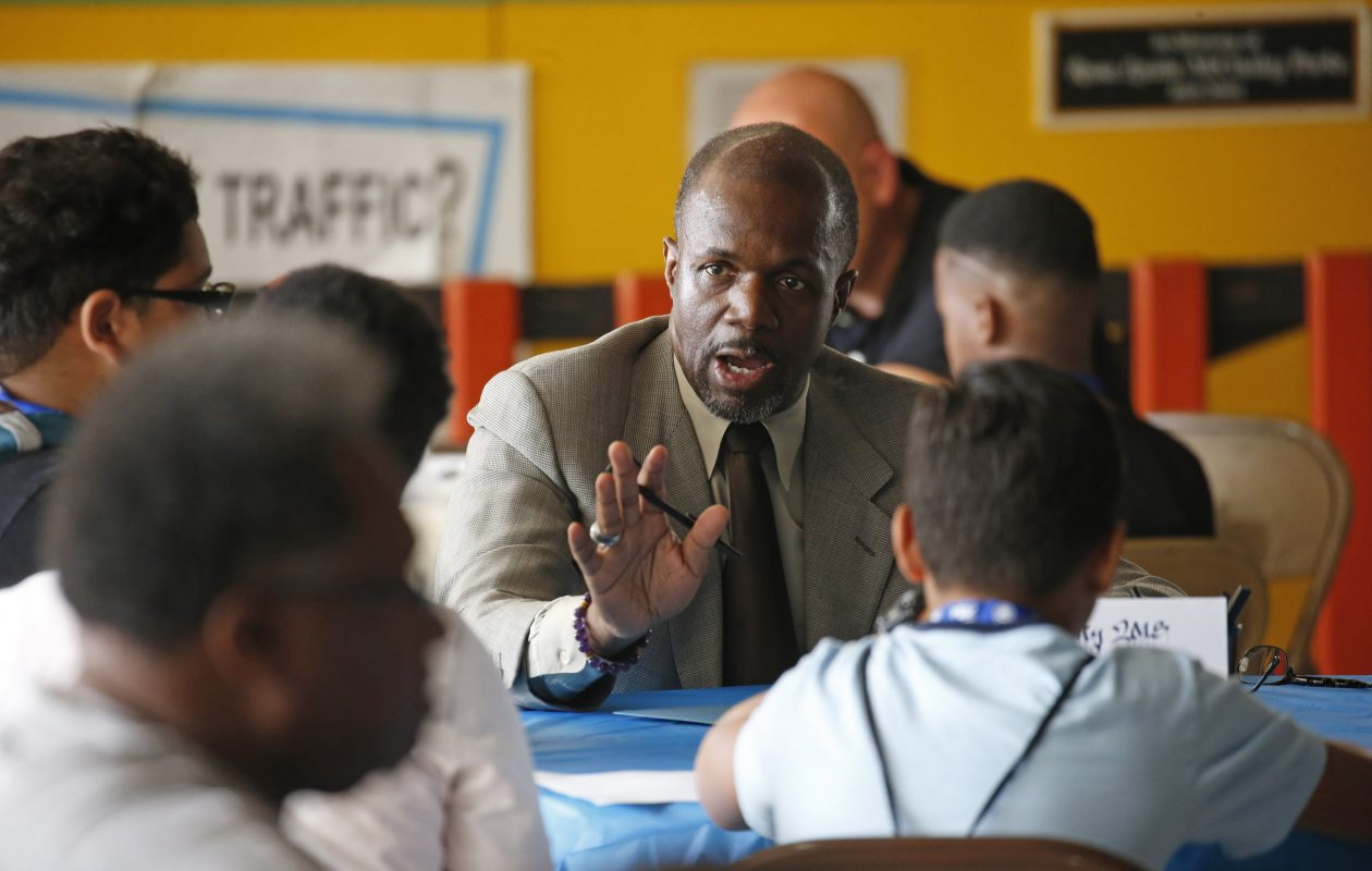 SUNY Buffalo State director of bands Rick Fleming speaks to a group of teenage boys at the kick-off of My Brother's Keeper in Buffalo. The program offers valuable examples of productive, successful lives. (Robert Kirkham/Buffalo News)