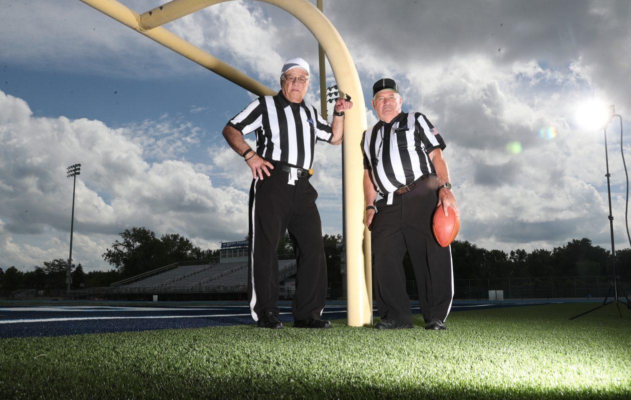 Paul Gagliardi (left) and Pat Dempsey are marking their 50th season as high school football officials. (James P. McCoy/Buffalo News)
