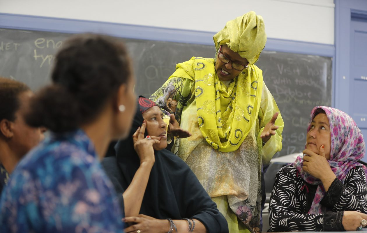 Suad Obsiye, a caseworker at the refugee resettlement program run by Catholic Charities of Buffalo, talks with clients on Friday. (Mark Mulville/Buffalo News)