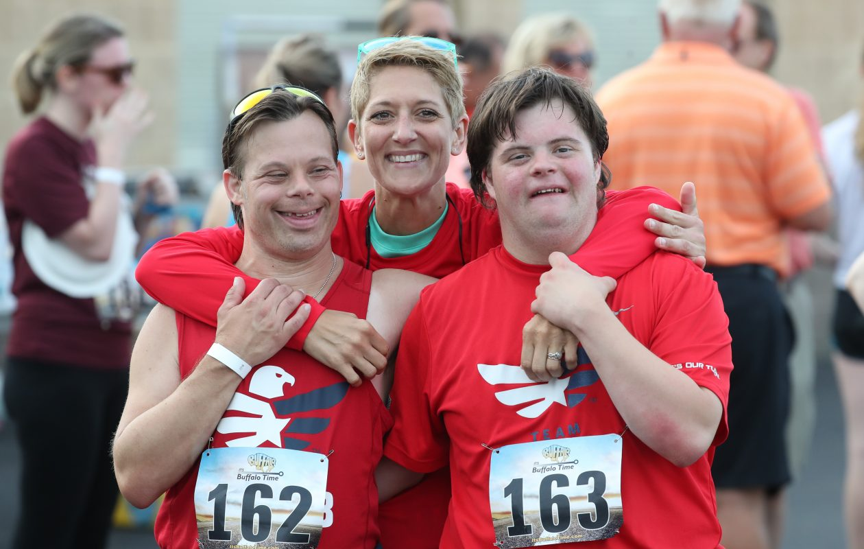 Ryan, left, and Noah Zygmunt  love to attend races with their sister, Dana Zygmunt. (James P. McCoy/Buffalo News)