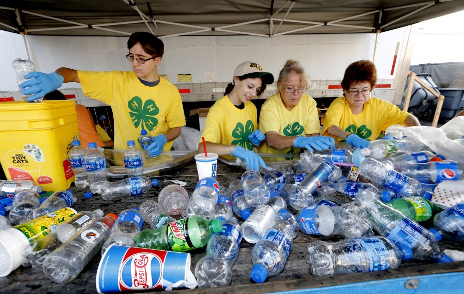 From left, John Pirrung, of Elma; Lauren Allan, of West Seneca; along with leaders of the Marilla Lads and Lassies 4-H Club Elizabeth Love, and Deb Mazur, both of Elma, sort through the various returnable bottles and cans on Wednesday, Aug. 15, 2018. 4-H volunteers collect the beverage containers sorting out the deposit friendly ones and use the money to support the 4-H programs.  (Robert Kirkham/Buffalo News)