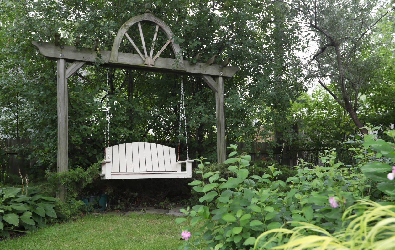 Donat Sadkowski, 91, has created a backyard oasis – planting all the beds and building the swing above. (Sharon Cantillon/Buffalo News)