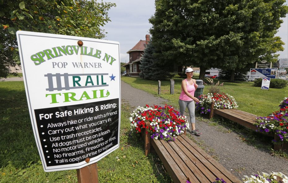 Janice Fritz loves walking the 1.7 mile Pop Warner Rail Trail near the old Springville Depot in Springville. The trail will be part of a 27-mile trail stretching from Orchard Park to Ashford. (Robert Kirkham/Buffalo News)