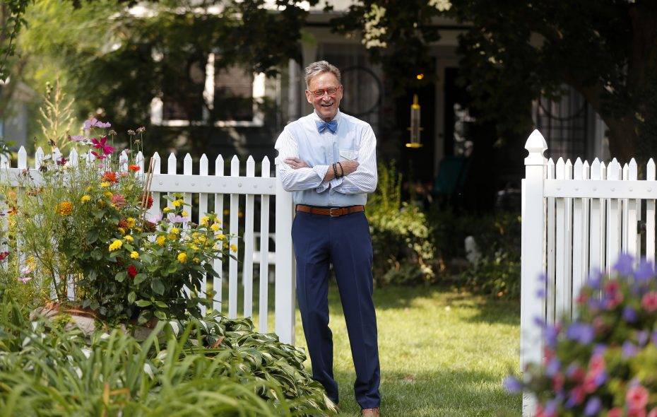 Robert P. Reeder in the garden at his home in Amherst.    (Mark Mulville/Buffalo News)
