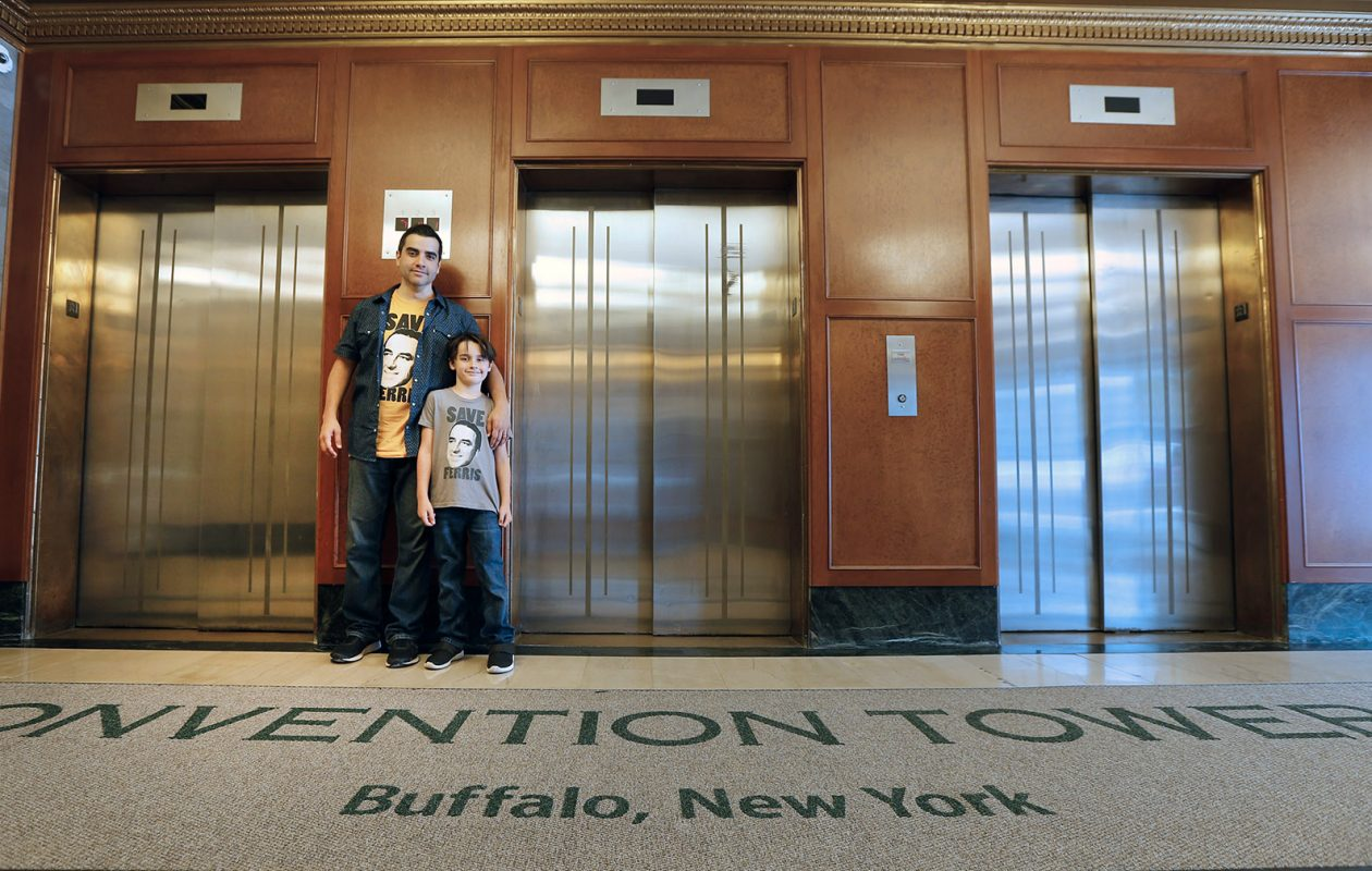 Christian Figueroa and his son, Christian Charles Figueroa, stand in the lobby of the Convention Tower, long known as the Walbridge Building; Christian's great-uncle Leo Ferris, created the old Buffalo Bisons basketball team in that   building, a franchise that evolved into today's Atlanta Hawks of the National Basketball Association - a league Ferris helped to found. (Robert Kirkham/Buffalo News)