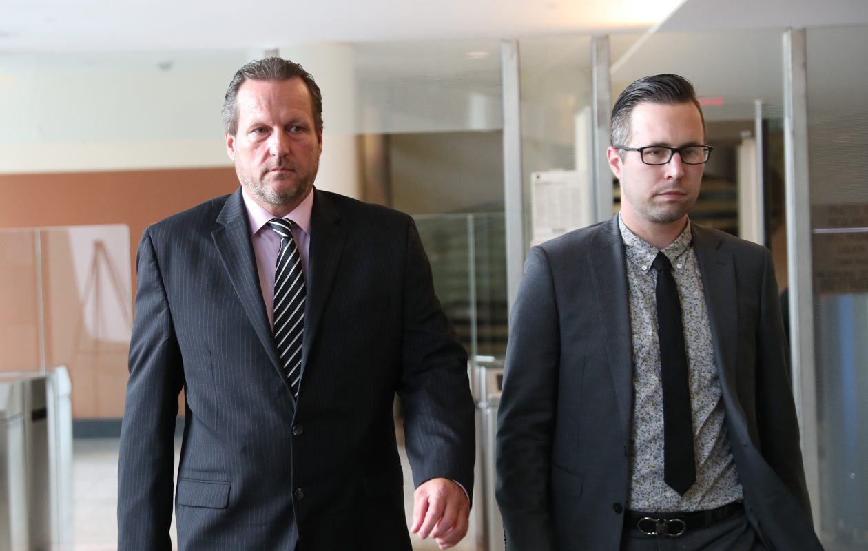 Former Lt. Gregory Kwiatkowski, left, leaves federal court after testifying on Thursday with lawyer Justin Ginter. (Sharon Cantillon/Buffalo News)