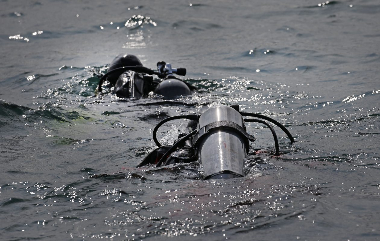 Brad White and Scott Grossman, divers from the U.S. Enfironmental Protection Agency, head out on their quest for samples of water and mussels in Lake Ontario on Monday. (Robert Kirkham/Buffalo News)
