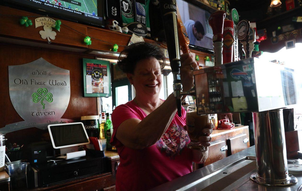 Adolf's bartender Fay Baron pours a Newcastle. (Sharon Cantillon/Buffalo News)