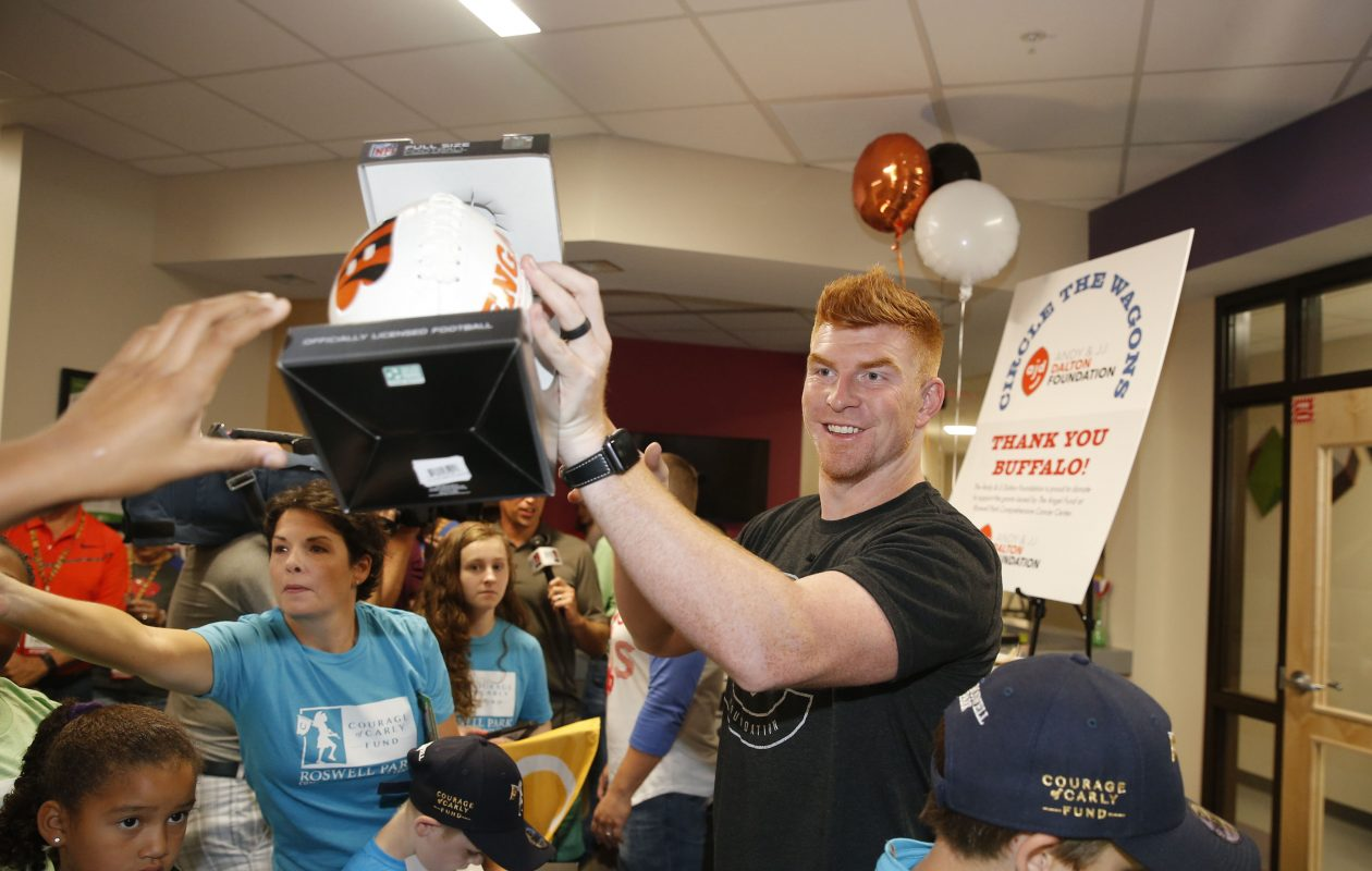 Cincinnati Bengals quarterback Andy Dalton and his wife Jordan and representatives of the Dalton Foundation presented a check and visited the pediatric care unit at Roswell Park on Sunday, Aug. 26, 2018. The Dalton Foundation made a donation in appreciation of Bills fans raising money after the Bengals helped the Bills make the playoffs last season. (Robert Kirkham/Buffalo News)