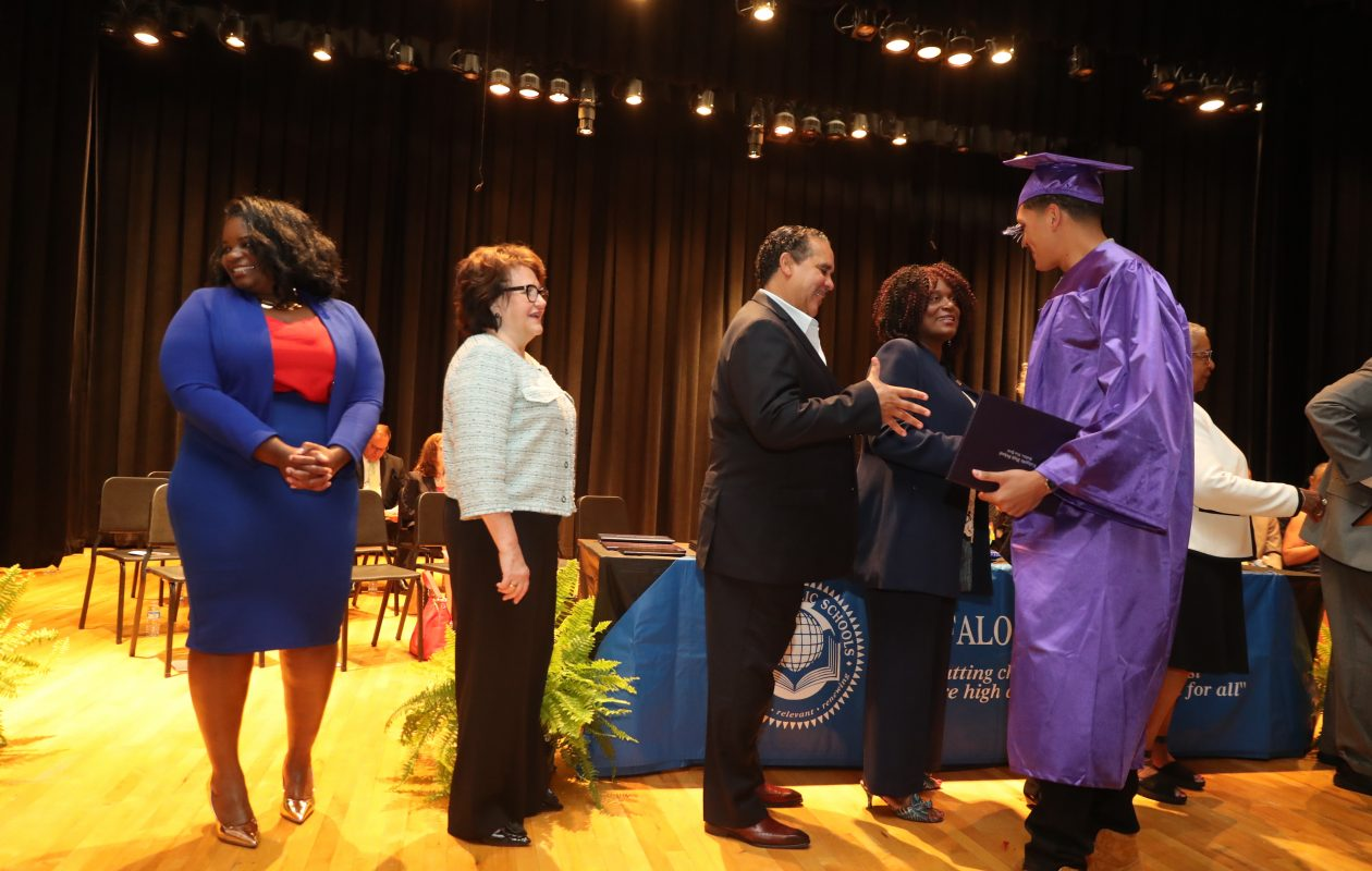 From left, Erie County Legislator April Baskin, Education Commissioner MaryEllen Elia, Superintendent Kriner Cash, and Ferry District School Board Member Sharon Belton-Cottman,  congratulate Maurice Brown of International Preparatory School as receives his high school diploma at the districtwide summer commencement Friday. (John Hickey/Buffalo News)