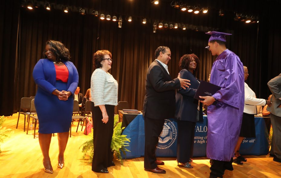 From left, Erie County Legislator April Baskin, Education Commissioner MaryEllen Elia, Superintendent Kriner Cash, and Ferry District School Board Member Sharon Belton-Cottman,  congratulate Maurice Brown of International Preparatory School as receives his high school diploma at a districtwide August 2018 commencement. (John Hickey/Buffalo News)