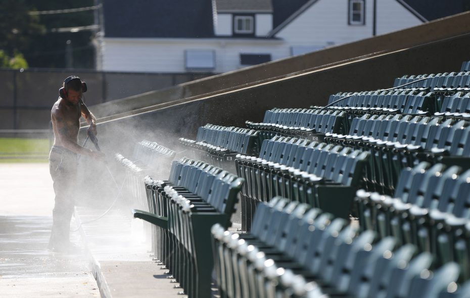 On a warm Wednesday, Pat Occhino power washes the seats at the Robert E. Rich, Sr. All High Stadium at Bennett High School on Main St in Buffalo. (Mark Mulville/Buffalo News)