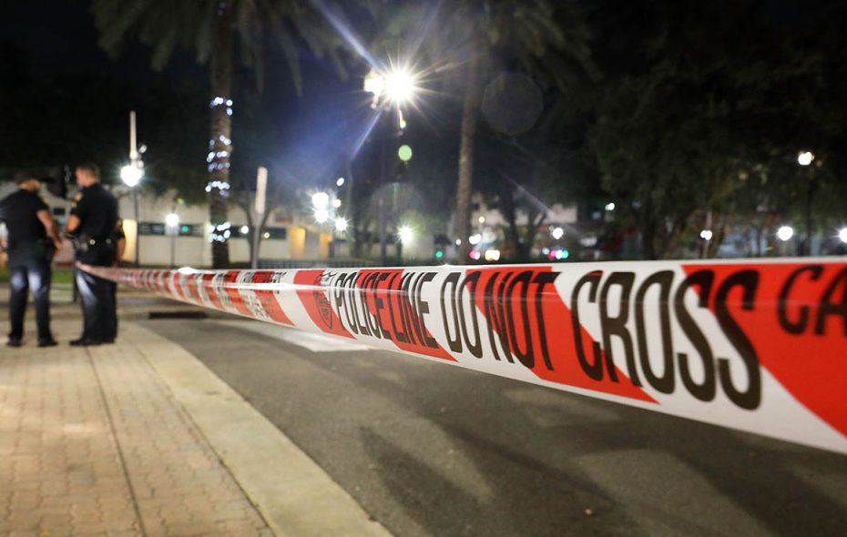 Police tape is seen as law enforcement officials investigate a shooting at the GLHF Game Bar on Aug. 27 in Jacksonville, Fla. (Joe Raedle/Getty Images)