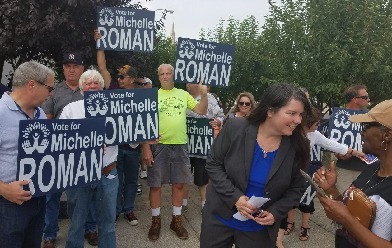 Michelle M. Roman, Democratic candidate for mayor of Lockport, greets supporters outside City Hall Aug. 15, 2018. (Thomas J. Prohaska/Buffalo News)