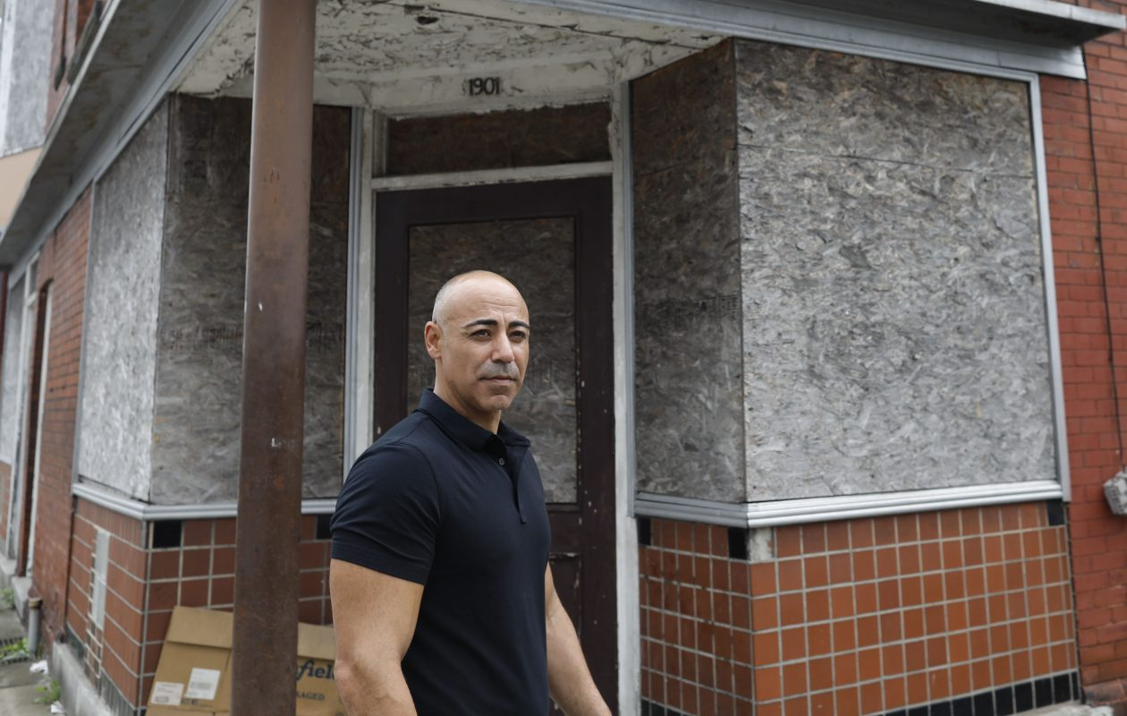 Eyal Cohen of AEC Development Corp. walks past a building on Niagara Street that he recently purchased and plans to rehab. (Derek Gee/Buffalo News)