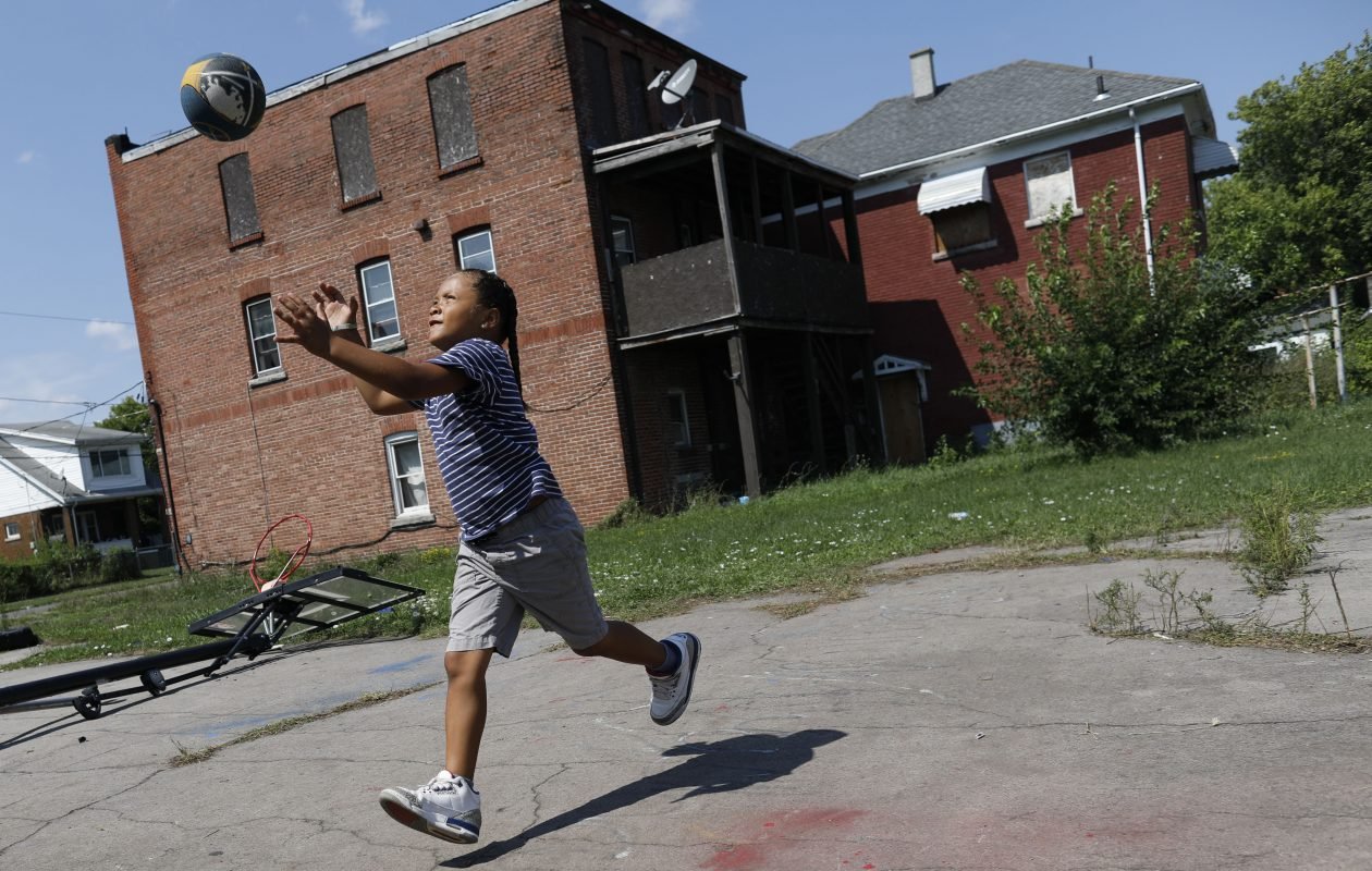 'Baby Shawn' Kennedy, 7, plays basketball outside his Niagara Falls home. Shawn was diagnosed with a brain tumor three years ago. (Derek Gee/Buffalo News)