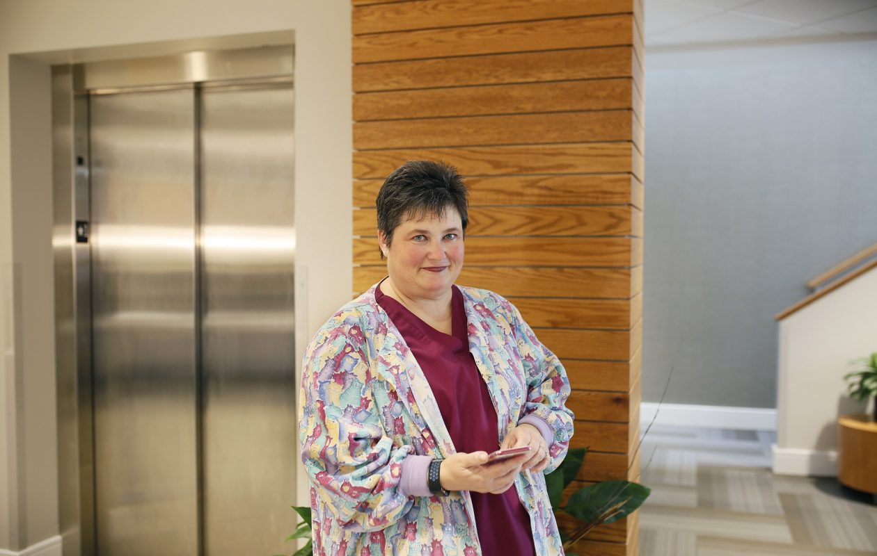 Betsy Manning, a patient service representative at a Town of Tonawanda medical diagnostic center, uses an app to help manager her diabetes. (Independent Health photo/Special to the News)