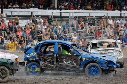Competitors smash and crash into each other, with the last vehicle able to move under its own power emerging as winner in the World's Largest Demolition Derby afternoon show on the final day of the Erie County Fair.