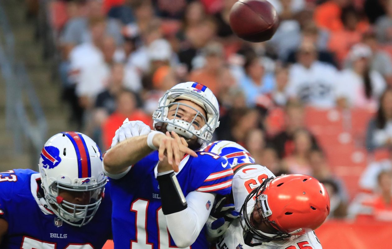 Bills QB AJ McCarron gets hit by Browns' Myles Garrett during first-quarter action at FirstEnergy Stadium on Friday, Aug. 17, 2018, in Cleveland. (Harry Scull Jr./Buffalo News)