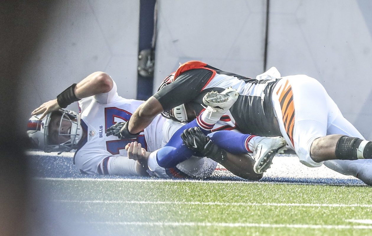 Cincinnati Bengals defensive end Carlos Dunlap tackles Buffalo Bills quarterback Josh Allen and forced him out of the game in the second quarter during the third preseason game. (James P. McCoy/Buffalo News)