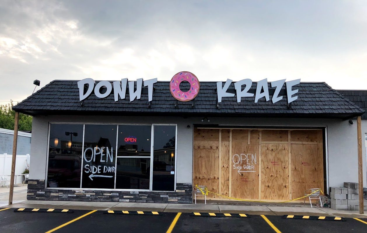 The Donut Kraze shop in the Town of Tonawanda was boarded up after a car plowed into it Friday morning. No one was hurt in the crash, which was blamed on a malfunctioning vehicle. (Stephen T. Watson/Buffalo News)