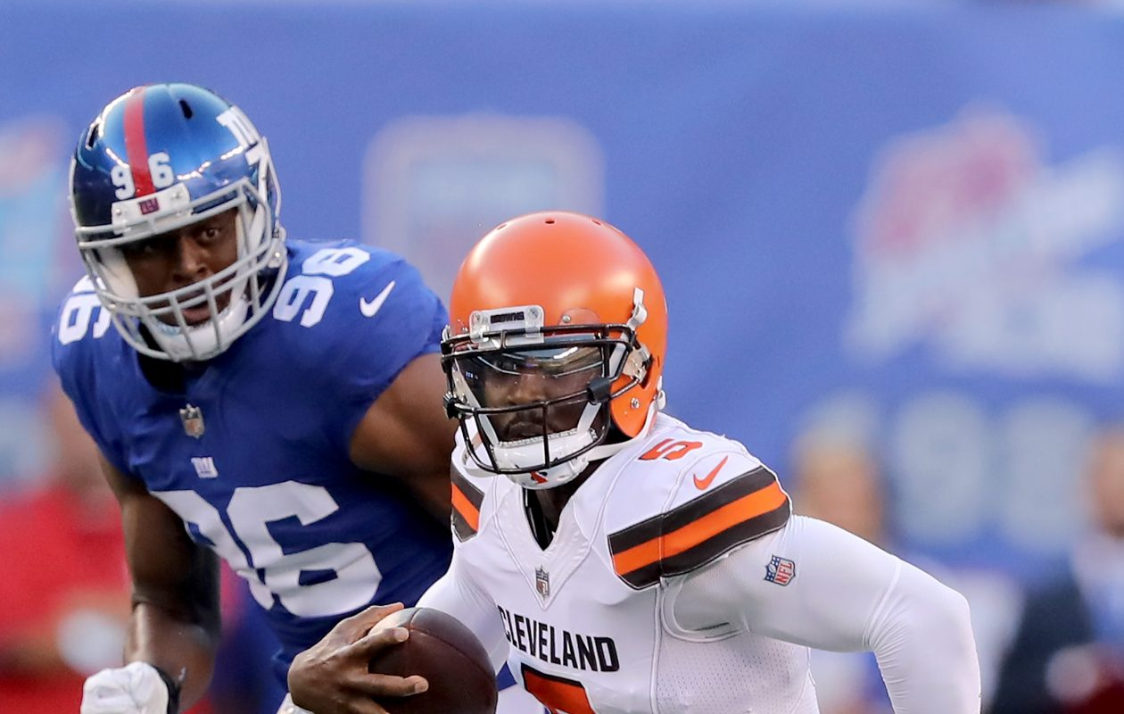 Tyrod Taylor #5 of the Cleveland Browns tries to get the first down as Kareem Martin #96 of the New York Giants defends during their preseason game on August 9,2018 at MetLife Stadium in East Rutherford, New Jersey.  (Photo by Elsa/Getty Images)