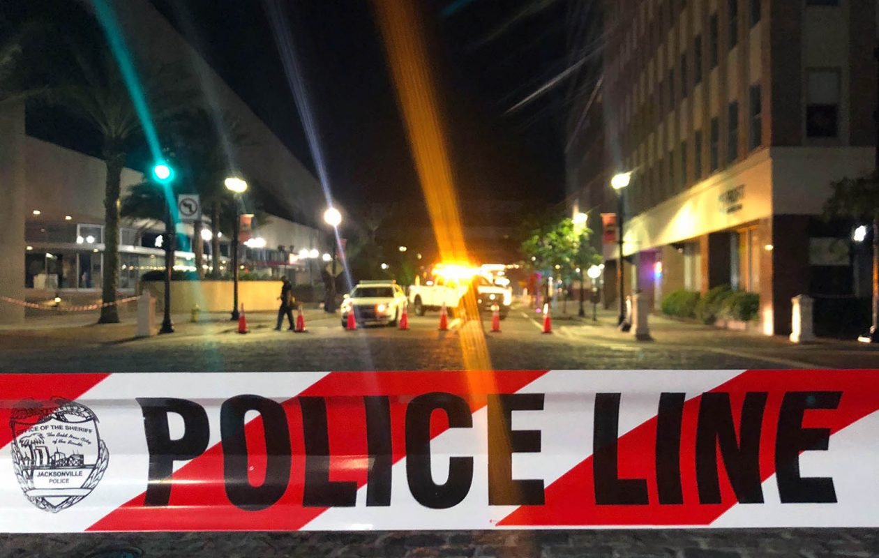 Police tape blocks a street leading to the Jacksonville Landing area where David Katz killed two people and himself, and wounded 11 others. (GIANRIGO MARLETTA/AFP/Getty Images file photo)