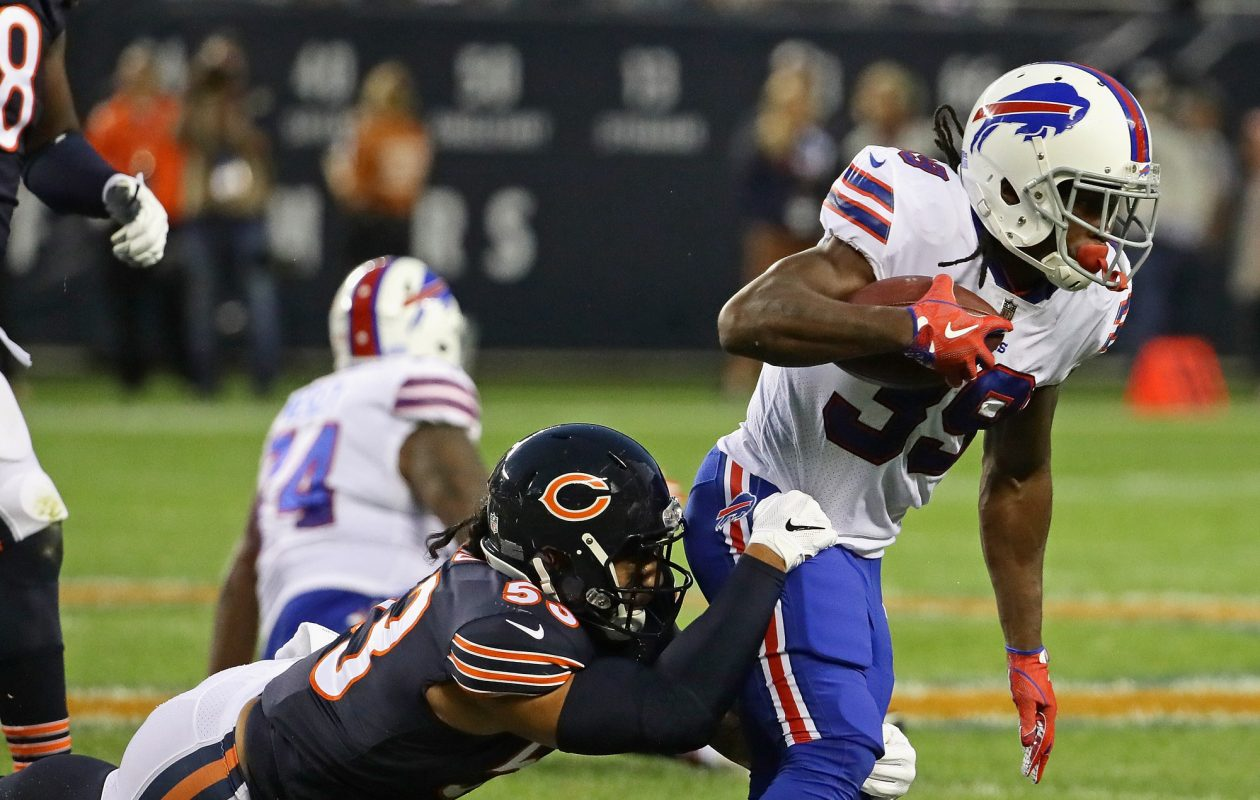 Travaris Cadet is dropped by John Timu of the Chicago Bears during a preseason game Thursday at Soldier Field. (Jonathan Daniel/Getty Images)