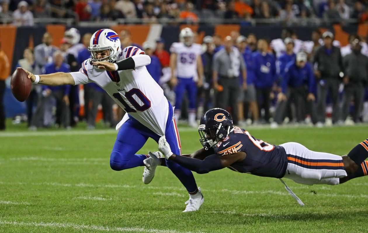 AJ McCarron breaks away for a rushing touchdown Thursday night against the Bears.  (Getty Images)