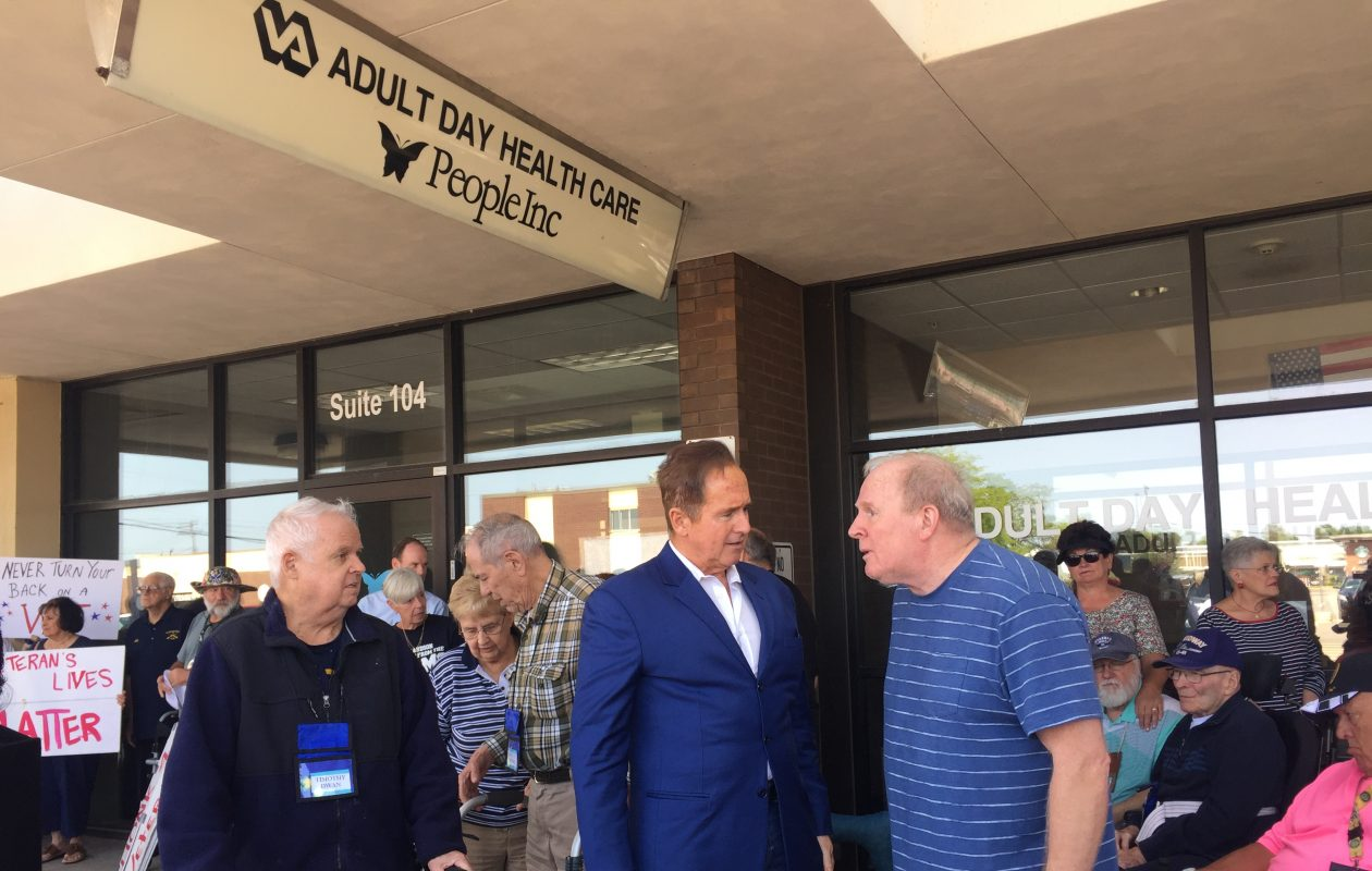 Rep. Brian Higgins, center left, speaks to veterans and their families at a news conference held Aug. 23, 2018, to decry the closing of a Veterans Affairs clinic in Amherst. (Photo provided by the office of Rep. Brian Higgins)