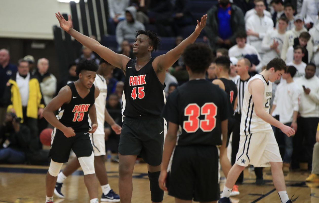 Park's Julian Eziukwu celebrates a victory over Canisius in the Manhattan Cup Class A final last winter. He was a key weapon for the Pioneers during their run to the state Federation championship. (Harry Scull Jr./Buffalo News)