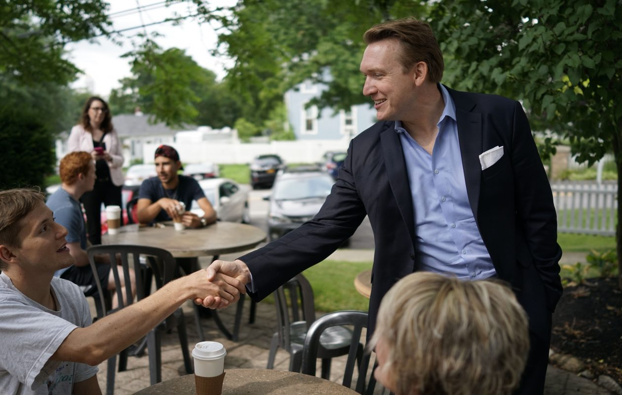 Nathan McMurray shakes hands with Matthew Baker in Lewiston in August. (Derek Gee/Buffalo News)