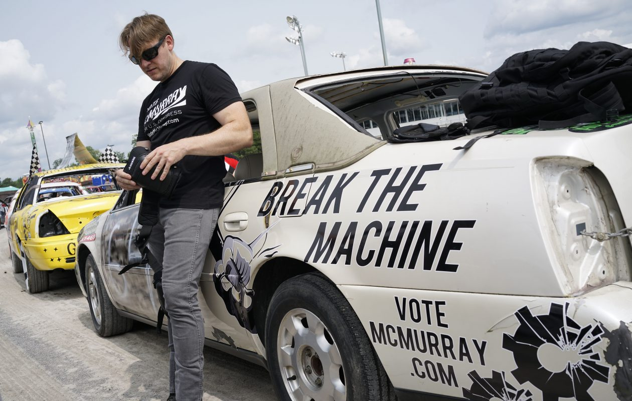 Grand Island Supervisor Nate McMurray, who is running for Chris Collins' seat in the House of Representatives, prepares to drive in the World's Largest Demolition Derby at the Erie County Fair. (Derek Gee/Buffalo News)