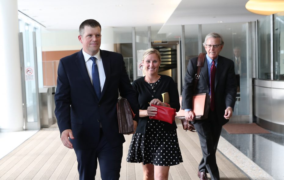 Defendant Raymond Krug, left, leaves federal court on Thursday, Aug. 16, 2018. In center is his wife, Shannon, and on right is his lawyer, Terrence Connors. (Sharon Cantillon/Buffalo News)