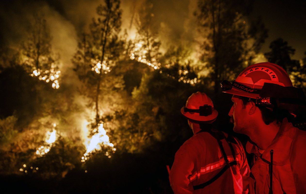 Firefighters monitor a burn operation near the town of Ladoga, Calif., on Aug. 7. (Marcus Yam/Los Angeles Times/TNS file photo)