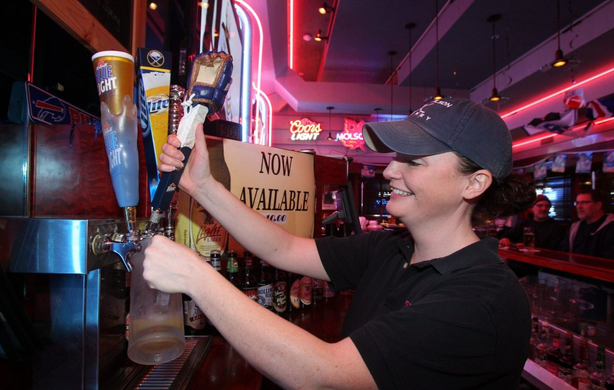 Bartender Katie Snyder serves up a 22-ounce draft beer at Zebb's Grill, on Southwestern Blvd., in 2013.  (Sharon Cantillon/Buffalo News)