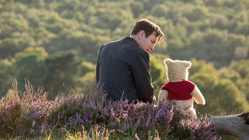 "Christopher Robin (Ewan McGregor) with his long-time friend Winnie the Pooh in Disney's ""Christopher Robin."""