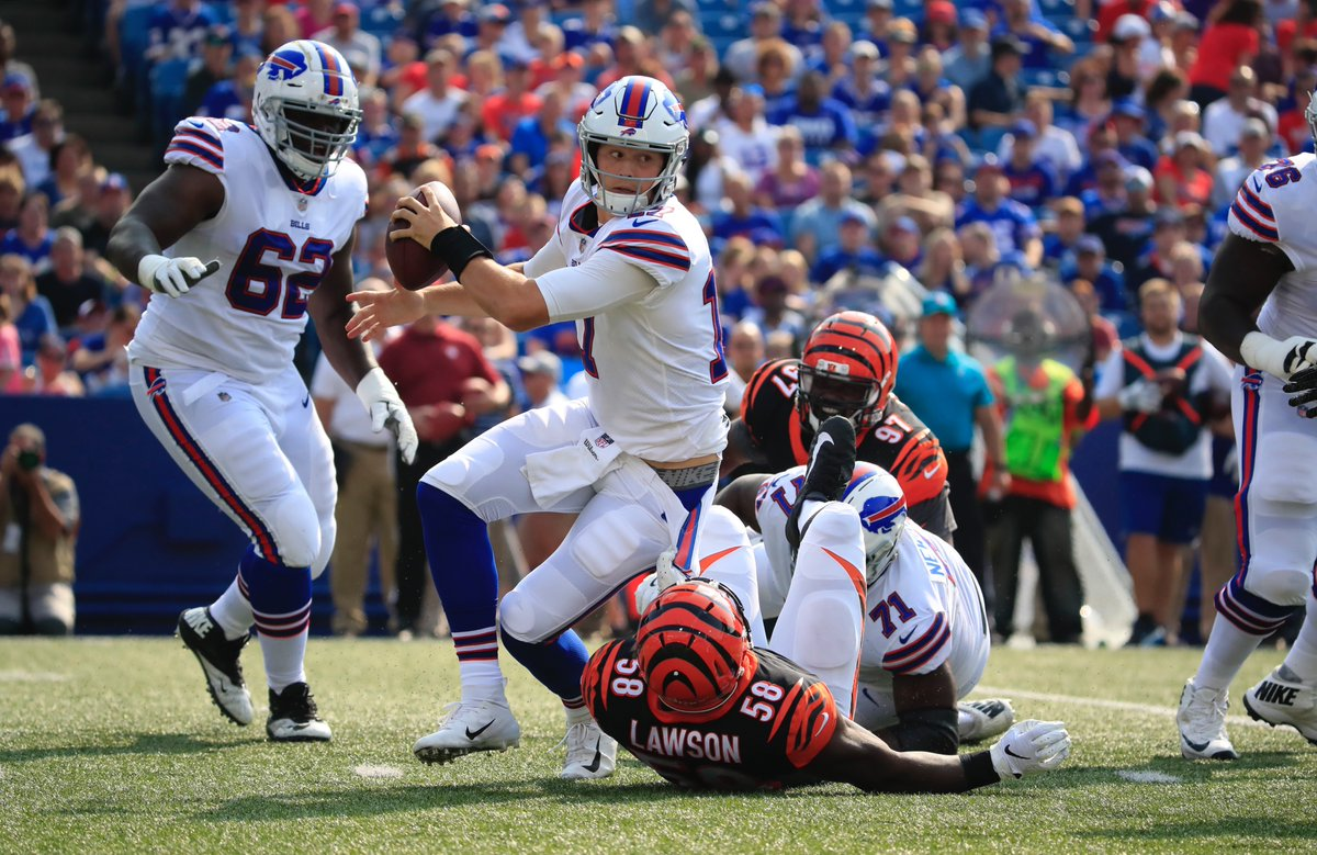 Josh Allen is sacked by the Bengals' Carl Lawson. (Harry Scull Jr./Buffalo News)