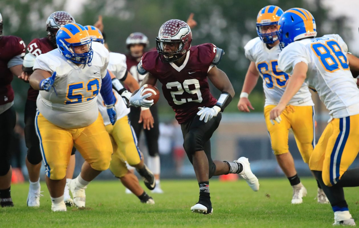 Rashad Law breaks through the Cleveland Hill defense during Maryvale's season-opening triumph Friday at Maryvale Stadium. (Harry Scull Jr./Buffalo News)