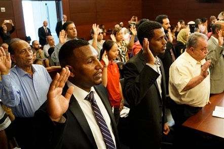 For the 115th year, new Americans officially become U.S. citizens