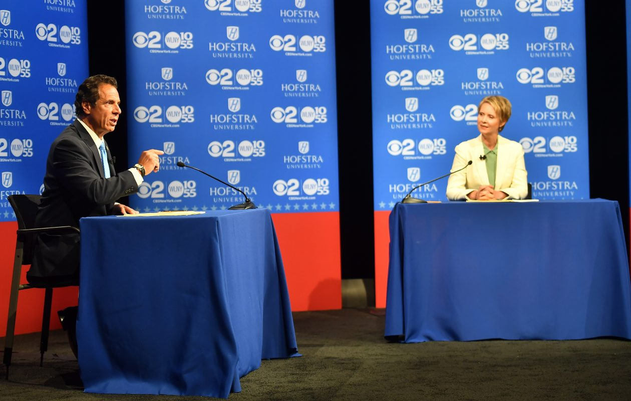 Gov. Andrew Cuomo speaks at the Democratic gubernatorial primary debate as Cynthia Nixon listens at Hofstra University in Hempstead. (Photo courtesy of Newsday)