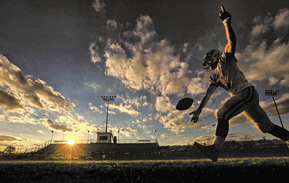 Springville's Ian Baker works on punting in pregame prior to playing Cheektowaga at Cheektowaga High School on Friday, Oct. 30, 2015.  (Harry Scull Jr./Buffalo News)