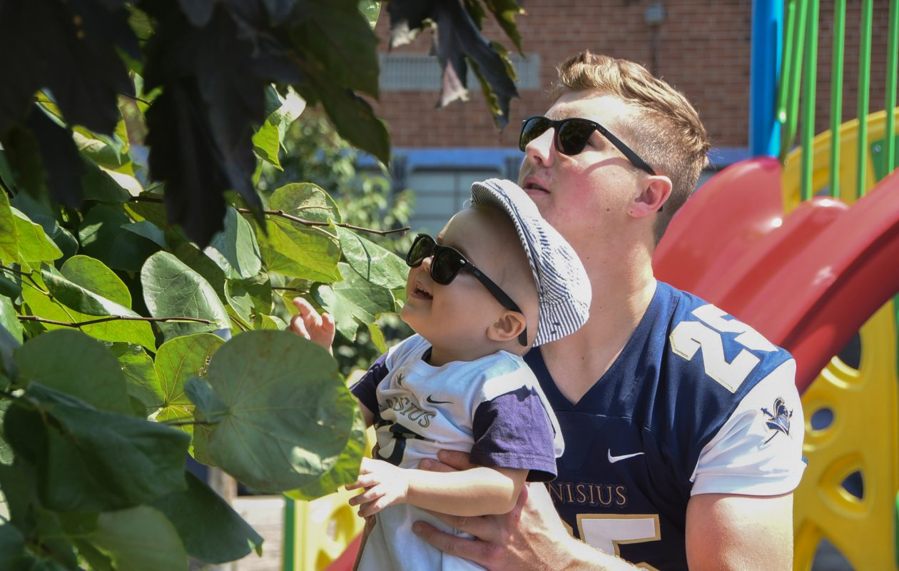 Tristian Vandenberg is a kicker from Canisius High in Buffalo and a Ohio University football recruit, with his 3-year-old cousin, Jack Baer, who is fighting leukemia. (Photo by Curt Hudson)
