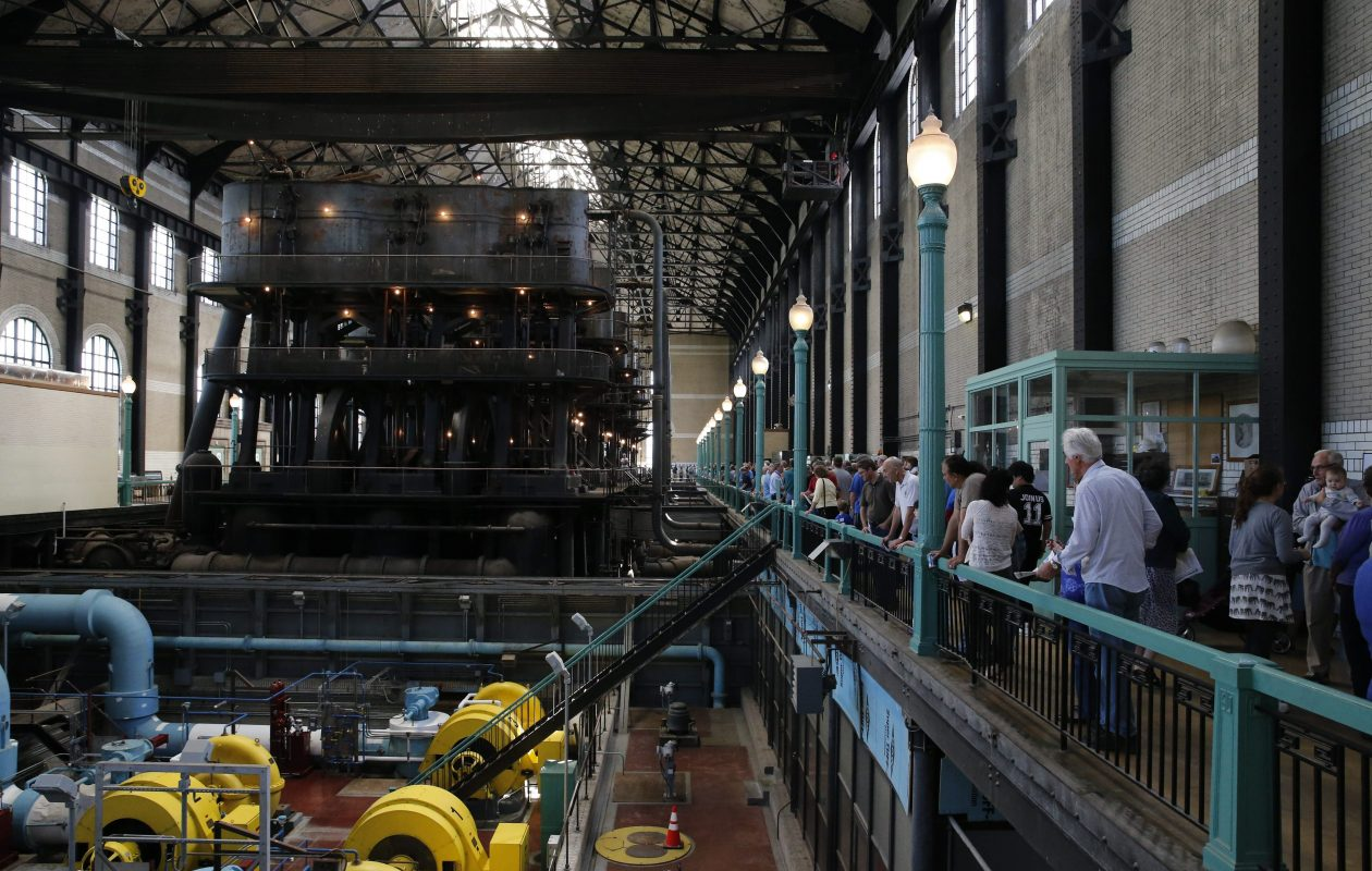 Visitors view the five, enormous steam engines, background, inside the Col. Ward Pumping Station during a tour by the Industrial Heritage Committee, Saturday, Sept. 20, 2014. (Derek Gee/Buffalo News)