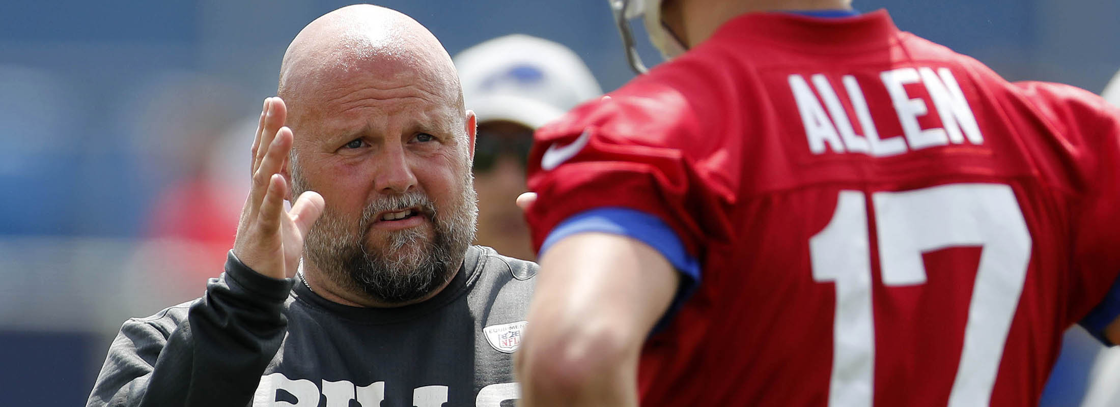 Bills offensive coordinator Brian Daboll talks with QB Josh Allen. (Mark Mulville/News file photo)