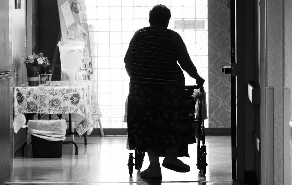 A resident walks down a hallway at Emerald South Nursing and Rehabilitation Center. on Delaware Avenue. (Robert Kirkham/Buffalo News)