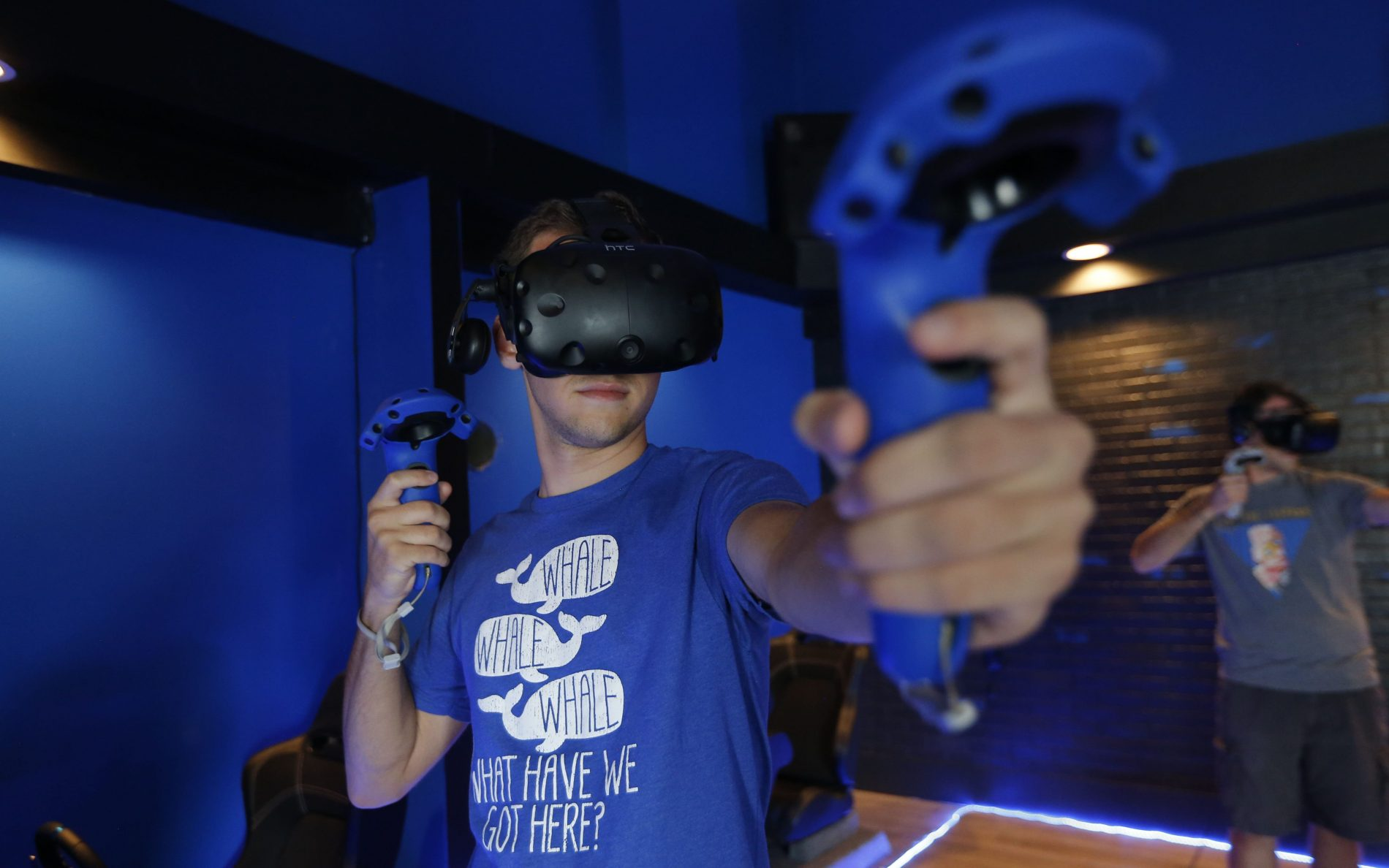 Simon Wulf takes the stance as an archer while playing the game 'Elven Assassin' at Vivid VR. (Robert Kirkham/Buffalo News)
